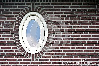 Oval window in brick wall