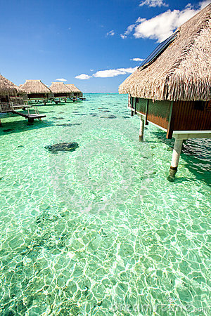 Over water bungalows over amazing green lagoon