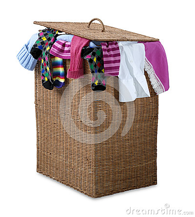 Overflowing wicker laundry basket  path
