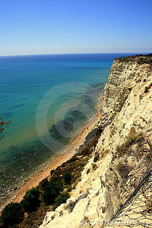 Overhanging clay rock on turquoise sea