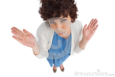 Overhead of a confused  woman gesturing