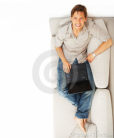 Overhead view of a happy man using a laptop