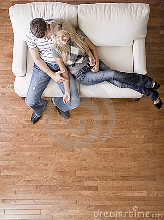 Free Overhead View Of Couple On Love Seat Royalty Free Stock Photos - 12857528