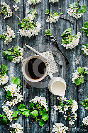 Free Overhead View Of Cup Of Black Coffee, Milk, Pen, Glasses And White Flowers And Branches  On White Background Stock Photos - 71507903