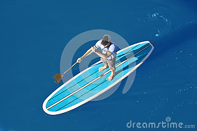 Overhead view of stand up paddleboarder