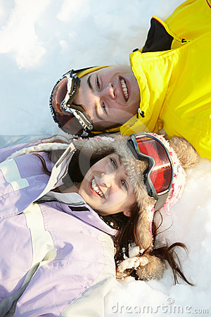 Overhead View Of Two Teenagers On Ski Holiday