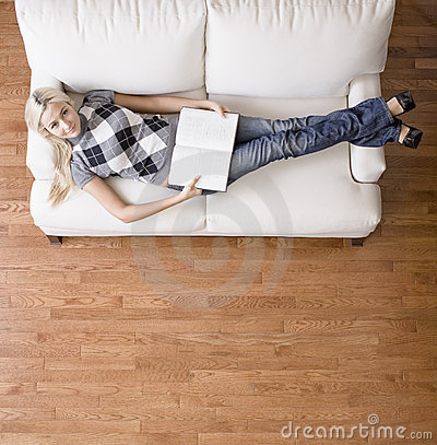 Overhead View Of Woman With Book On Couch Royalty Free Stock Images - Image: 12892839