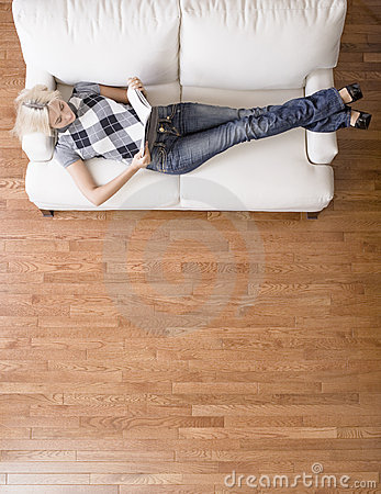Overhead View of Woman Reading on Couch
