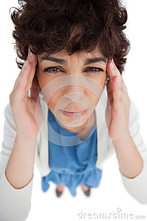 Overhead of woman with a headache touching her temples