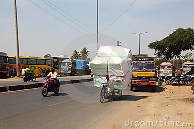 Overloaded bicycle delivery, India Editorial Photography