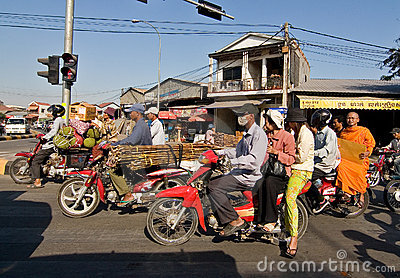 Overloaded motorcycles in Phnom Penh Cambodia Editorial Image