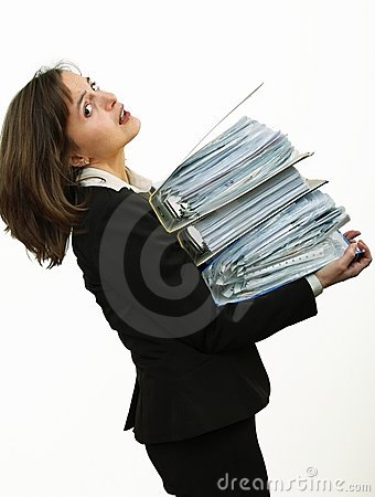 Overloaded? Woman with heavy files