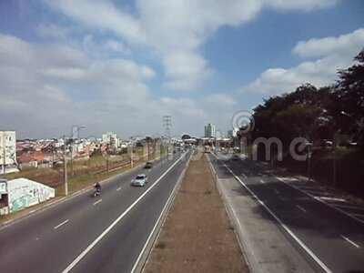 Road, Campinas,  Sao Paulo, Brazil. Overview of road, cars and sky, Campinas,  Sao Paulo, Brazil stock video