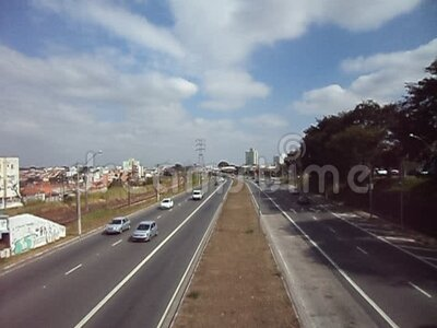 Road, Campinas,  Sao Paulo, Brazil. Overview of road, cars and sky, Campinas,  Sao Paulo, Brazil stock footage