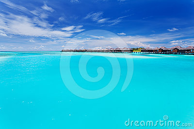 Overwater villas in blue laggon of Maldives