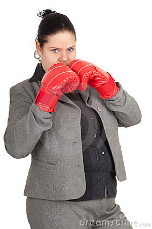 Overweight, fat businesswoman in boxing gloves
