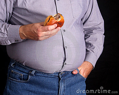 Overweight man eating a cheeseburger