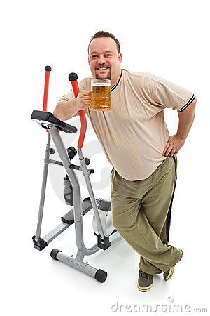 Overweight man having a beer after working out