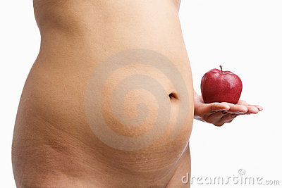 Overweight woman body holding apple