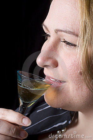Overweight woman having a drink
