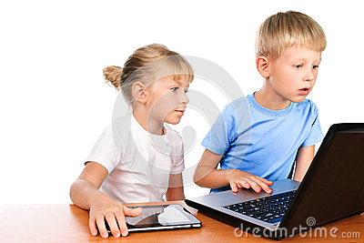 Overwhelmed boy and girl using laptop