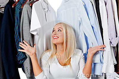 Overwhelmed woman with clothes