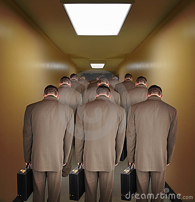 Overworked Business Men Walking down Hallway