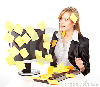 Overworked businesswoman with stickers on computer