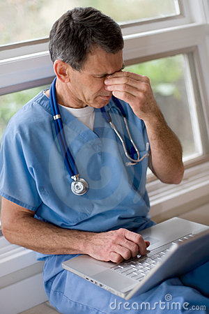 Free Overworked, Overstressed Doctor Stock Images - 4446954
