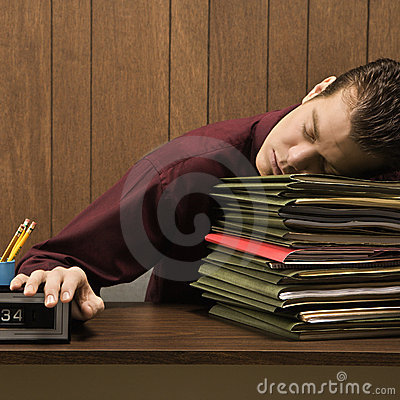 Overworked retro businessman sleeping at desk.