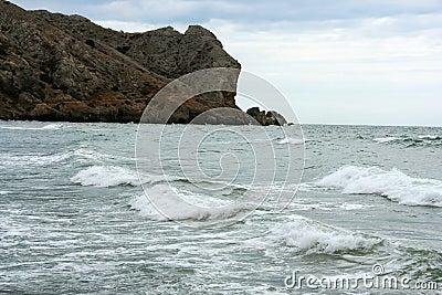 Overzees met golven