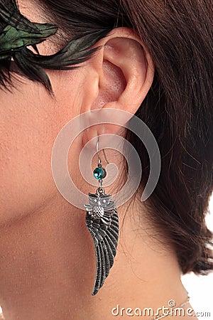 Owl shaped earring ear