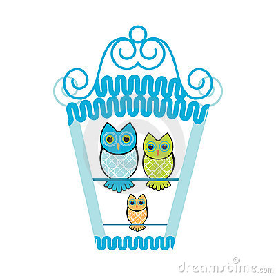 Owls in a birdhouse