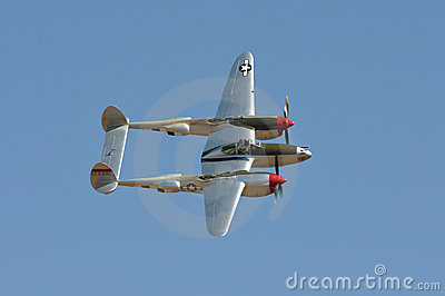 P-38 Flying Against Blue Sky Editorial Photo