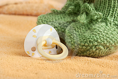 Pacifier and the baby booty on a blanket