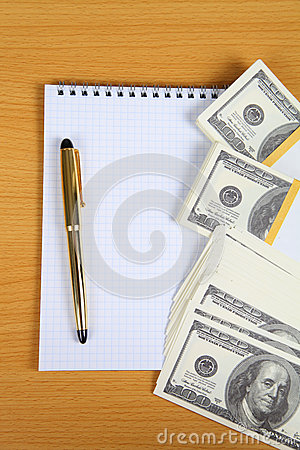 Pack of banknotes and notebook