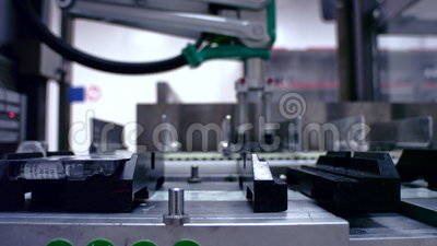 Packaged goods at automated production line. Manufacturing line at factory. Manufacturing line at medical factory. Close up of medicine packaging line at stock video footage