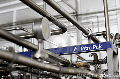 Packaging system in dairy factory- Tetra Pak Editorial Stock Photo