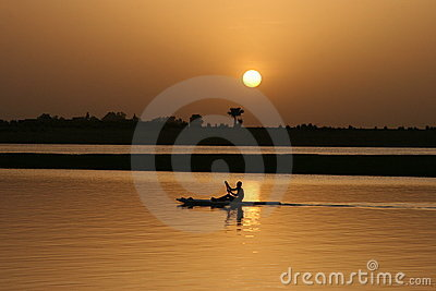 Paddling on the water at sunset