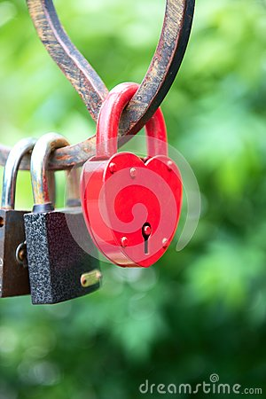 Padlock as a heart on the bridge