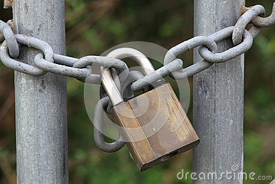 Padlock on chain close-up