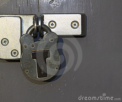 Padlock on grey door