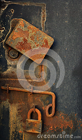 Padlock on old metal door