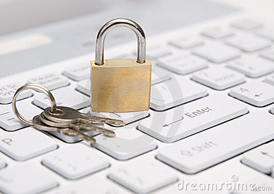Padlock on white keyboard.
