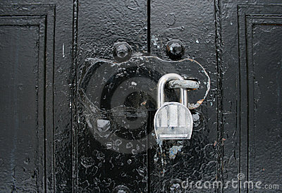 Padlocked black doors