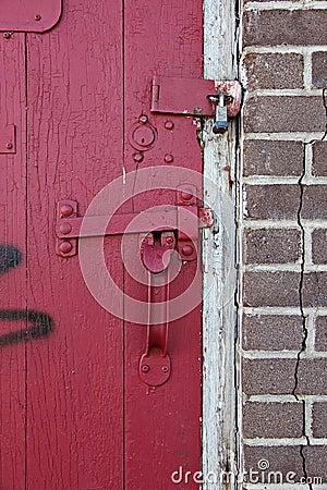 Padlocked red door