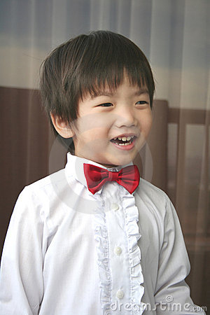 Page boy with red bow-tie smiling