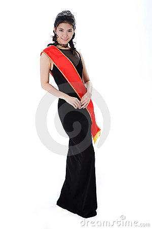 Pageant queen wearing red sash