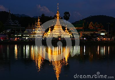 The pagoda and lighting reflect the water
