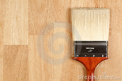 Paint Brush on Wood Surface